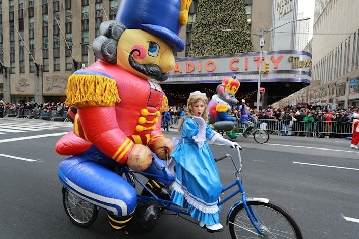 Clara joins the character of Tchaikovsky's famous holiday ballet Nutcracker on a high-speed Trycaloon chase alongside the Mouse King in the 93rd Macy's Thanksgiving Day Parade in New York. (Photo: Gordon Donovan/Yahoo News)