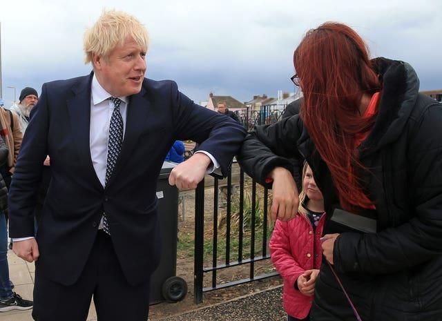 Prime Minister Boris Johnson greets members of the public with an elbow bump as he campaigns on behalf of Conservative Party candidate Jill Mortimer in Hartlepool