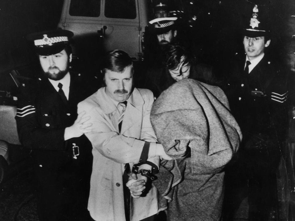 Peter Sutcliffe, aka The Yorkshire Ripper, is brought into Dewsbury Court under a blanket (Getty Images)