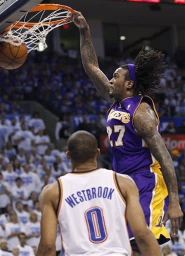 Los Angeles Lakers center Jordan Hill, right, dunks in front of Oklahoma City Thunder guard Russell Westbrook (0) during the second quarter in Game 2 of an NBA basketball playoffs Western Conference semifinal, in Oklahoma City on Wednesday, May 16, 2012. (AP Photo/Sue Ogrocki)