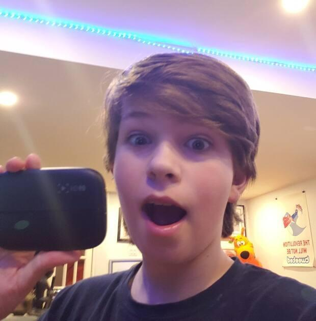 McCurdy holds up his latest trade: an Elgato capture card HD60 used to capture game play and transfer videos.