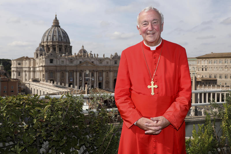 Archbishop of Westminster and President of the Catholic Bishops' Conference of England and Wales Vincent Gerard Nichols poses in front the St. Peter's Basilica during a reception for the Cardinal Newman Canonization at Pontifical Urban College, Sunday, Oct. 13, 2019 in Vatican City, Vatican. Pope Francis on Sunday canonized Cardinal John Henry Newman, the 19th-century Anglican convert who became an immensely influential, unifying figure in both the Anglican and Catholic churches.(Franco Origlia/pool photo via AP)