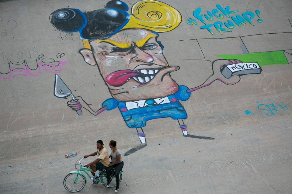 Picture of a graffiti against US Republican presidential hopeful Donald Trump painted by an unknown artist on the embankment of the Bravo River on the border with the United States, in Ciudad Juarez, Chihuahua State, Mexico, on June 28, 2016.