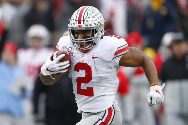 Ohio State running back J.K. Dobbins runs for a 33-yard touchdown against Michigan in the second half of an NCAA college football game in Ann Arbor, Mich., Saturday, Nov. 30, 2019. (AP Photo/Paul Sancya)
