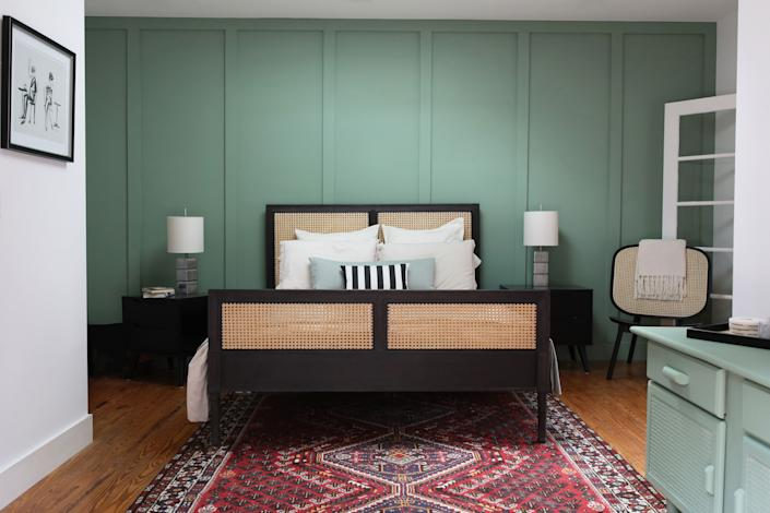 "<div class=""caption""> Summer's Day Paint by Benjamin Moore adds dimension to the guest bedroom. </div>"