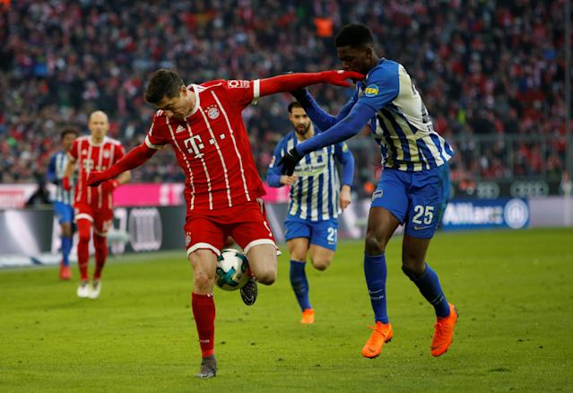 Soccer Football - Bundesliga - Bayern Munich vs Hertha BSC - Allianz Arena, Munich, Germany - February 24, 2018 Bayern Munich's Robert Lewandowski in action with Hertha Berlin's Jordan Torunarigha REUTERS/Michaela Rehle DFL RULES TO LIMIT THE ONLINE USAGE DURING MATCH TIME TO 15 PICTURES PER GAME. IMAGE SEQUENCES TO SIMULATE VIDEO IS NOT ALLOWED AT ANY TIME. FOR FURTHER QUERIES PLEASE CONTACT DFL DIRECTLY AT + 49 69 650050