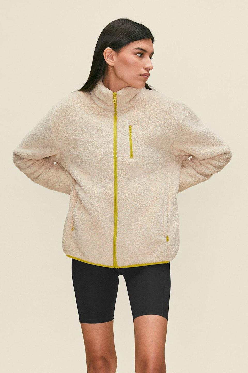 """Whether you're heading to and from the grocery store or taking a walk around the block, cozy up in this chic sherpa piece any time you're heading out the door. $128, Girlfriend Collective. <a href=""""https://www.girlfriend.com/products/cream-full-zip-sherpa"""" rel=""""nofollow noopener"""" target=""""_blank"""" data-ylk=""""slk:Get it now!"""" class=""""link rapid-noclick-resp"""">Get it now!</a>"""