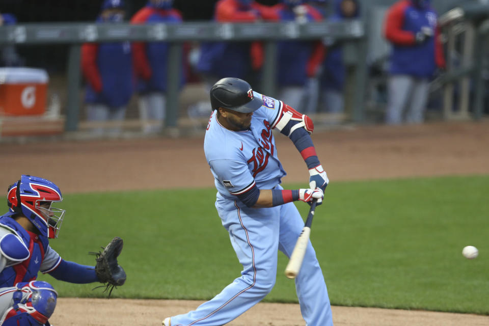 Minnesota Twins' Nelson Cruz strikes out against the Texas Rangers during the first inning of a baseball game Wednesday, May 5, 2021, in Minneapolis. (AP Photo/Stacy Bengs)
