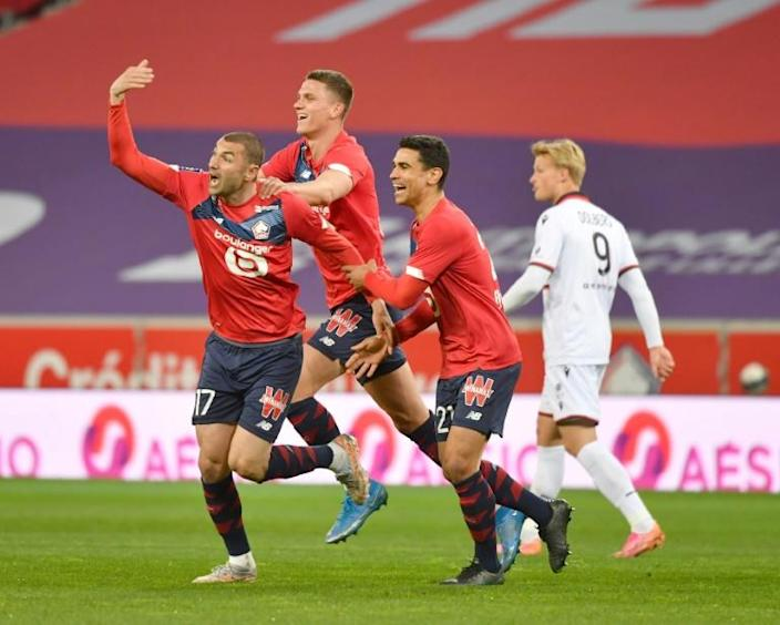 Burak Yilmaz celebrates with his team-mates after scoring Lille's first goal in their 2-0 win over Nice