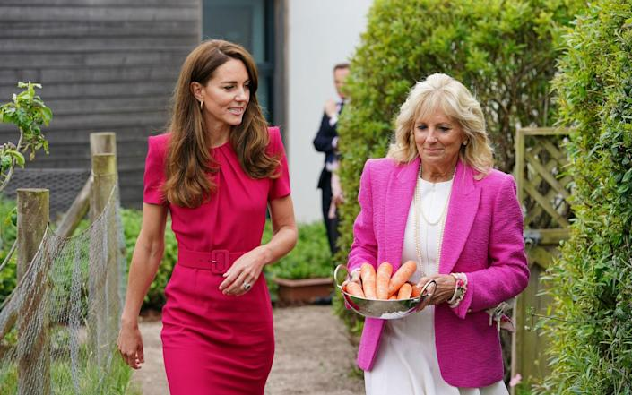 The Duchess of Cambridge and US First Lady Jill Biden, carrying carrots for the school rabbit, Storm - Aaron Chown/PA Wire
