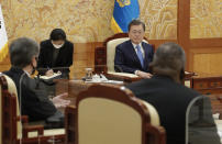 South Korean President Moon Jae-in, center, listens to U.S. Secretary of State Antony Blinken, left, and U.S. Defense Secretary Lloyd Austin, right, sits during their meeting at the presidential Blue House in Seoul, South Korea, Thursday, March 18, 2021. (AP Photo/Lee Jin-man, Pool)
