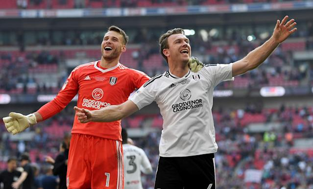 "Soccer Football - Championship Play-Off Final - Fulham vs Aston Villa - Wembley Stadium, London, Britain - May 26, 2018 Fulham's Kevin McDonald and Marcus Bettinelli celebrate promotion to the Premier League Action Images via Reuters/Tony O'Brien EDITORIAL USE ONLY. No use with unauthorized audio, video, data, fixture lists, club/league logos or ""live"" services. Online in-match use limited to 75 images, no video emulation. No use in betting, games or single club/league/player publications. Please contact your account representative for further details."