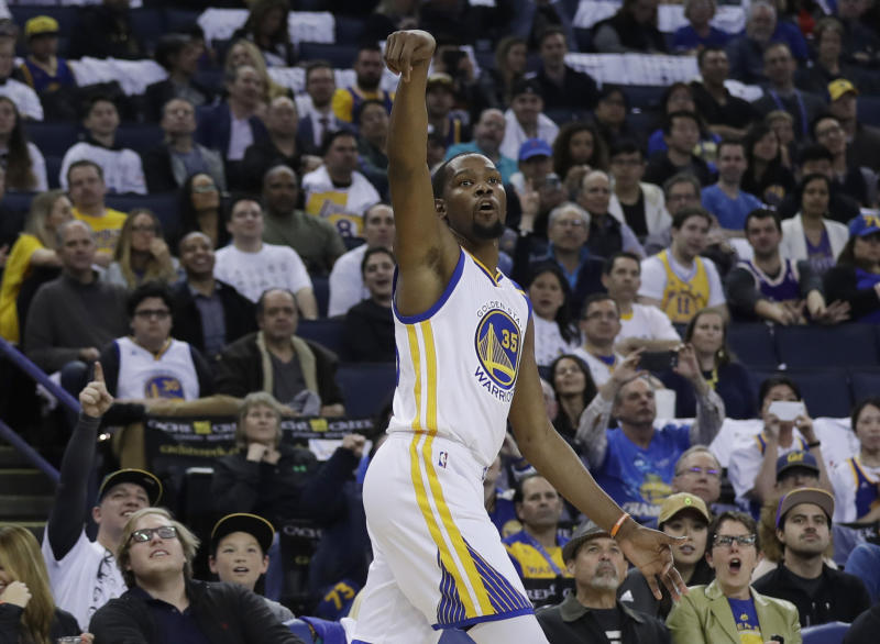 Golden State Warriors' Kevin Durant follows through on a 3-point basket during the second half of the team's NBA basketball game against the Los Angeles Lakers on Wednesday, April 12, 2017, in Oakland, Calif. (AP Photo/Marcio Jose Sanchez)