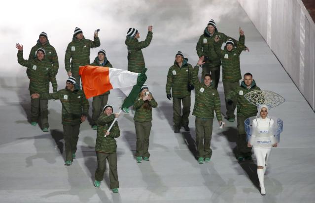 Ireland's flag-bearer Conor Lyne leads his country's contingent during the opening ceremony of the 2014 Sochi Winter Olympics, February 7, 2014. REUTERS/Lucy Nicholson (RUSSIA - Tags: OLYMPICS SPORT)