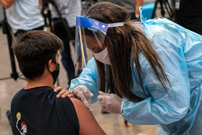 Marc Bugarin, 15, at a school-based COVID-19 vaccination clinic for students 12 and older in San Pedro, Calif., May 24, 2021.