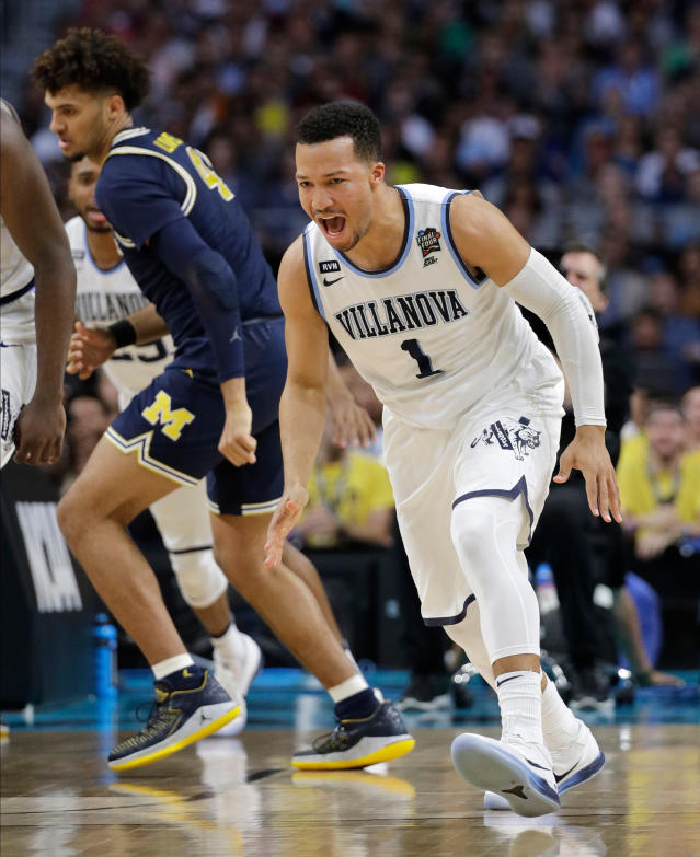 Villanova's Jalen Brunson (1) reacts after shooting a basket during the first half in the championship game of the Final Four NCAA college basketball tournament against Michigan, Monday, April 2, 2018, in San Antonio. (AP Photo/David J. Phillip)