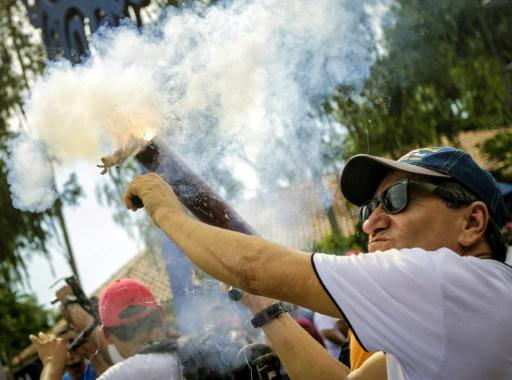 Supporters of Nicaraguan President Daniel Ortega fire mortars during a rally in the capital Managua