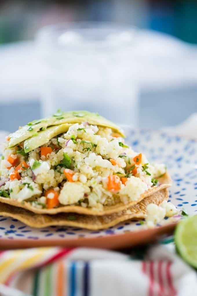 """<p>Enjoy the light and bright taste of tostadas, minus the seafood. This foodie-approved appetizer uses quinoa and cauliflower as a starting base and is accentuated by crunchy carrots and zesty spices.</p><p><a class=""""link rapid-noclick-resp"""" href=""""https://www.brownsugarandvanilla.com/vegan-ceviche-tostadas/"""" rel=""""nofollow noopener"""" target=""""_blank"""" data-ylk=""""slk:GET THE RECIPE"""">GET THE RECIPE</a></p><p><em>Per serving: 205 calories, 9 g fat (1 g saturated), 2,176 mg sodium, 29 g carbs, 4 g sugar, 5 g fiber, 5 g protein</em></p>"""