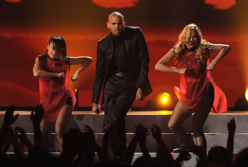 FILE - In this May 19, 2013 file photo, Chris Brown, center, performs at the Billboard Music Awards at the MGM Grand Garden Arena in Las Vegas. Brown is nominated for best male R&B artist at the 2013 BET Awards, and will perform in the show. The awards air live Sunday, June 30, 2013, from the Nokia Theatre L.A. Live, in Los Angeles. (Photo by Chris Pizzello/Invision/AP, File)
