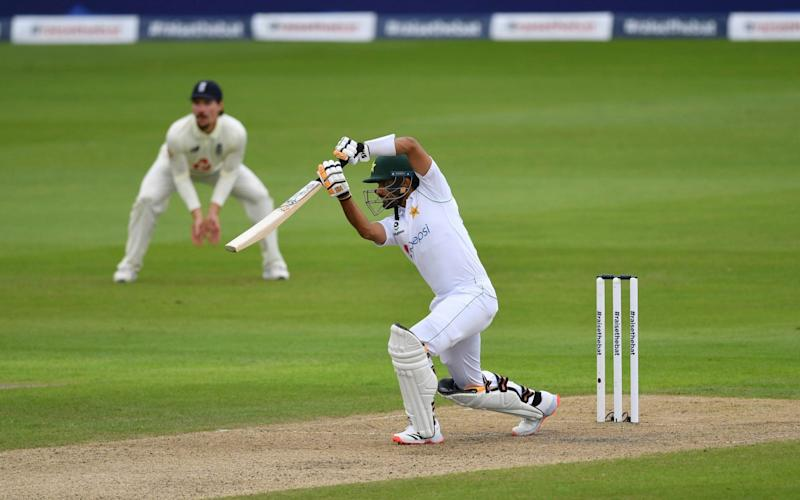 Babar Azam drives the ball through the covers for four - GETTY IMAGES