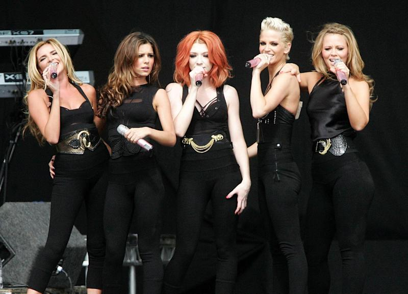 (L - R) Nadine Coyle, Cheryl Cole, Nicola Roberts, Sarah Harding and Kimberley Walsh of Girls Alouds perform on the second day of the V Festival at Hylands Park, Chelmsford, Essex.