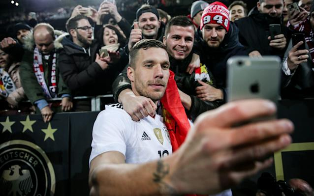 <span>Podolski takes a selfie as a memento of his night</span>