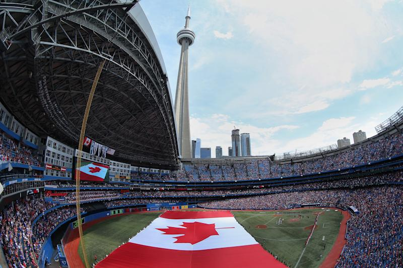 </a> TORONTO, CANADA - JULY 1: A general view of the Rogers Centre on Canada Day as a large Canadian flag is unfurled on the field during the singing of the Canadian anthem before the start of the Toronto Blue Jays MLB game against the Milwaukee Brewers on July 1, 2014 at Rogers Centre in Toronto, Ontario, Canada. (Photo by Tom Szczerbowski/Getty Images)Tom Szczerbowski Getty Images