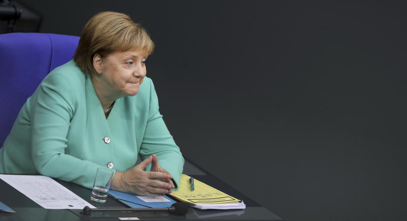 German Chancellor Angela Merkel attends a meeting of the German federal parliament, Bundestag, at the Reichstag building in Berlin, Germany, Thursday, Sept. 26, 2019. (AP Photo/Michael Sohn)
