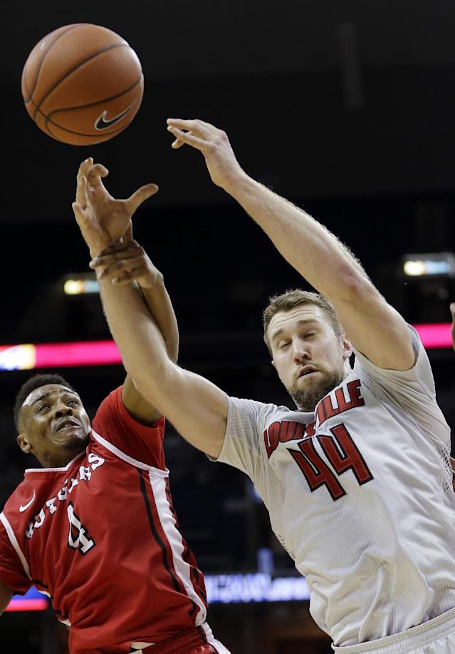 Louisville forward Stephan Van Treese (44) is fouled by Rutgers guard Myles Mack (4) during the first half of an NCAA college basketball game in the quarterfinals of the American Athletic Conference tournament Thursday, March 13, 2014, in Memphis, Tenn. (AP Photo/Mark Humphrey)