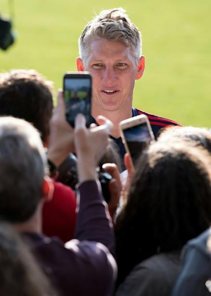 Bastian Schweinsteiger smiles as he meets fans on Sunday during a training session with Chicago Fire in Munich ahead of his testimonial on Tuesday against Bayern Munich at the Allianz Arena, when he will play a half each for both clubs