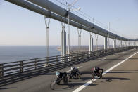 Participants in the wheelchair division make their way across the Verrazano-Narrows Bridge during the start of the New York City Marathon, Sunday, Nov. 3, 2019, in New York. (AP Photo/Julius Motal)