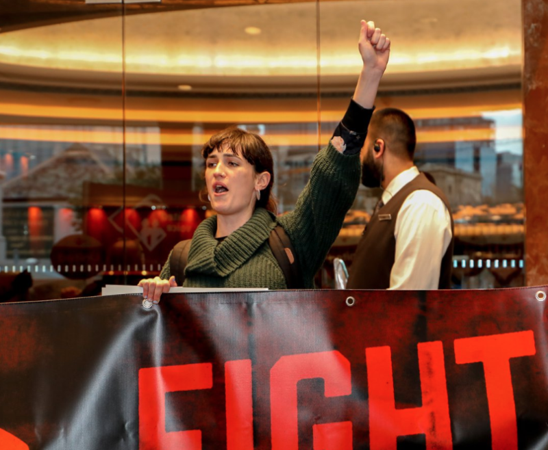 Orlaith Belfrage with her fist in the air at a rally for hospitality union Hospo Voice