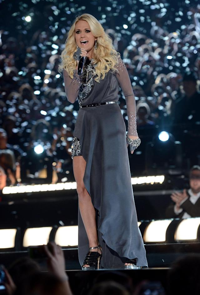 NASHVILLE, TN - NOVEMBER 01: Carrie Underwood performs during the 46th annual CMA Awards at the Bridgestone Arena on November 1, 2012 in Nashville, Tennessee. (Photo by Jason Kempin/Getty Images)