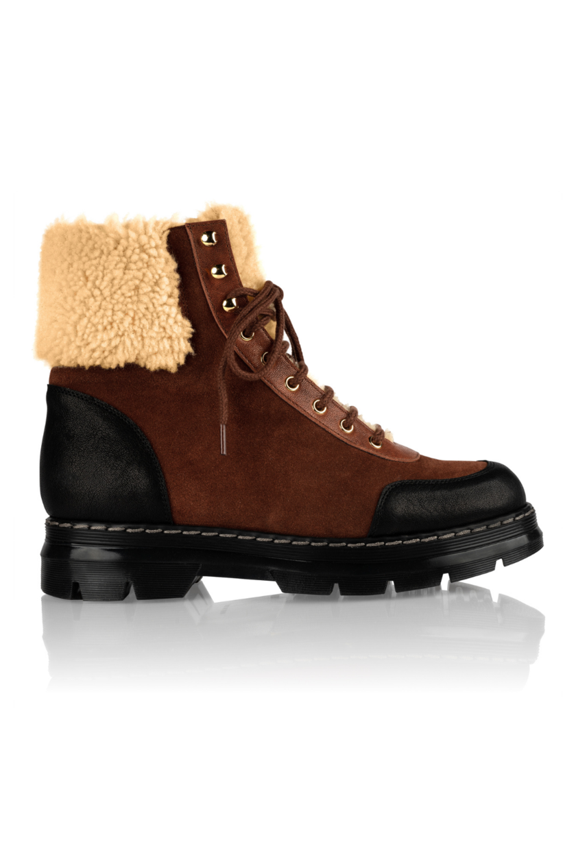"""<p><strong>Brother Vellies </strong></p><p>brothervellies.com</p><p><strong>$795.00</strong></p><p><a href=""""https://brothervellies.com/collections/all/products/alps-boot"""" rel=""""nofollow noopener"""" target=""""_blank"""" data-ylk=""""slk:SHOP IT"""" class=""""link rapid-noclick-resp"""">SHOP IT </a></p><p>This color-blocked pair from Brother Vellies will keep you warm in the colder months. </p>"""