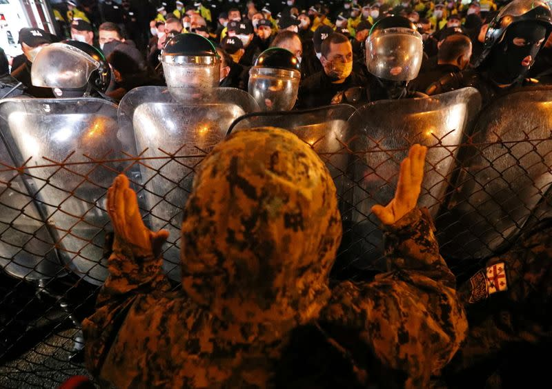 Opposition supporters protest against results of a parliamentary election in Tbilisi