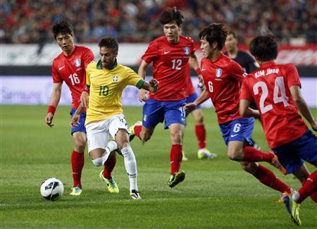 Brazil's Neymar (10) fights for the ball with South Korea's players during their friendly soccer match at the Seoul World Cup stadium October 12, 2013. REUTERS/Kim Hong-Ji