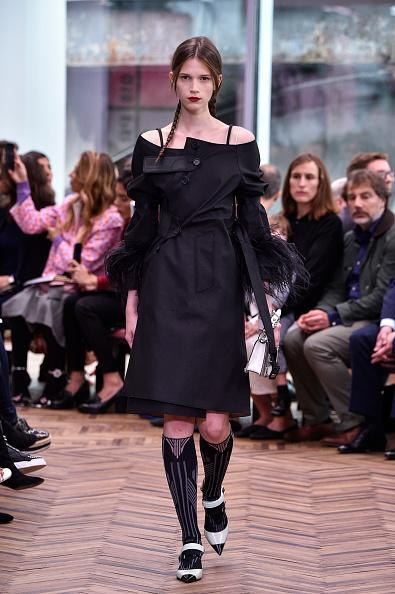 <p>A model walks the runway clad in a black dress at the Prada Resort Collection 2018 show at Osservatorio Prada in Milan. (Photo: Getty Images) </p>