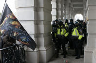 U.S. Capitol police push back demonstrators who are trying to break through a door of the U.S. Capitol on Wednesday, Jan. 6, 2021, in Washington. (AP Photo/Jose Luis Magana)