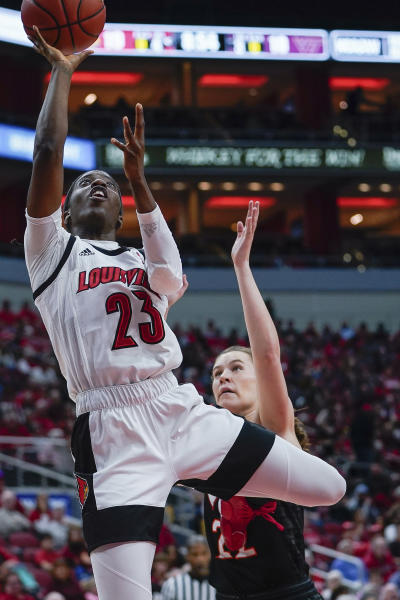 Louisville guard Jazmine Jones (23) shoots during the first half of a women's NCAA college basketball game against Virginia Tech, Sunday, March 1, 2020, at the KFC YUM Center in Louisville, Ky. (AP Photo/Bryan Woolston)