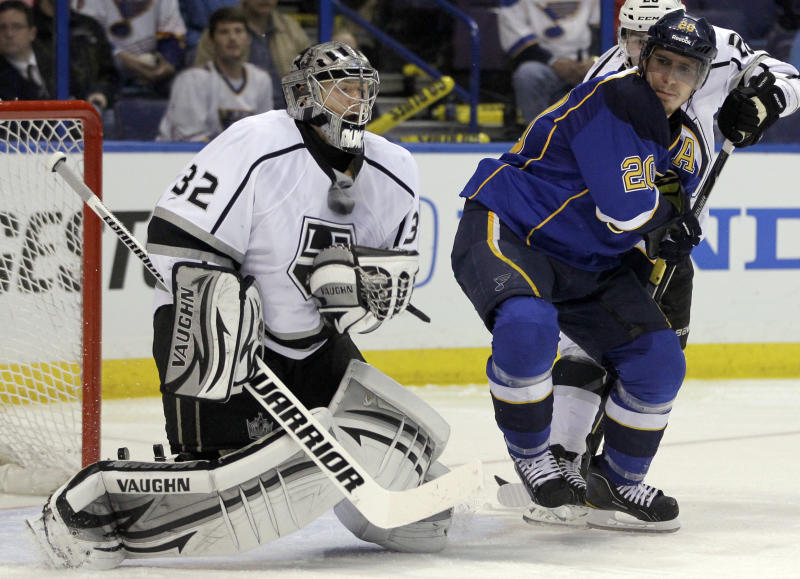 Los Angeles Kings goalie Jonathan Quick, left, makes a save in front of St. Louis Blues' Alexander Steen during the second period of Game 1 in a second-round NHL Stanley Cup hockey playoff series, Saturday, April 28, 2012, in St. Louis. (AP Photo/Jeff Roberson)