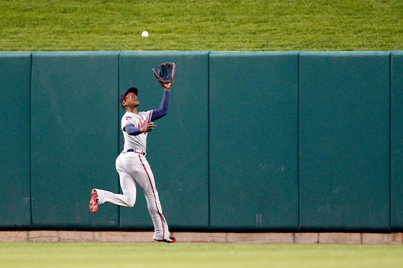 Atlanta Braves center fielder B.J. Upton goes after but is unable to catch a deep fly ball hit by St. Louis Cardinals' Allen Craig resulting in an RBI double during the second inning of a baseball game Friday, May 16, 2014, in St. Louis. (AP Photo/Scott Kane)