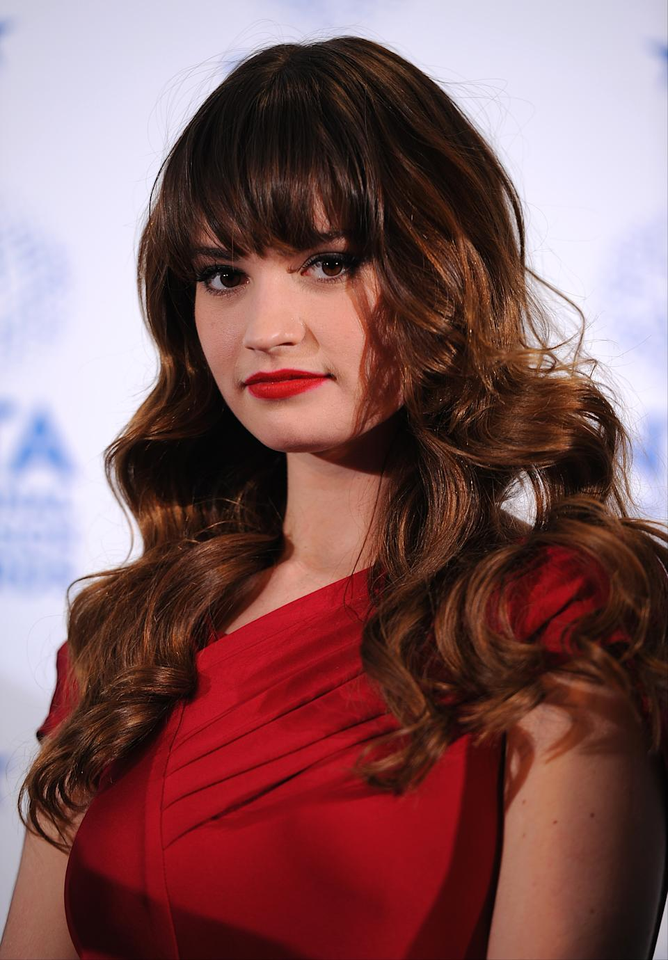 Lily James in the press room at the 2013 National Television Awards at the O2 Arena, London.