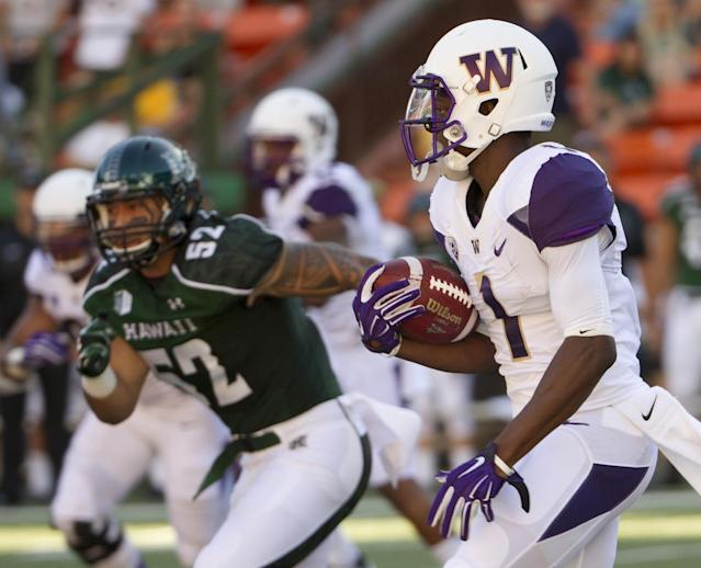 Hawaii linebacker Tevita Lataimua (52) attempts to chase down Washington wide receiver John Ross as Ross returns a kickoff in the first quarter of an NCAA college football game, Saturday, Aug. 30, 2014, in Honolulu. (AP Photo/Eugene Tanner)