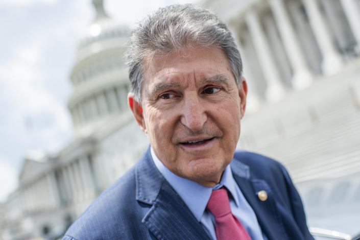 Sen. Joe Manchin, D-W.Va., talks with reporters after a vote in the Capitol on Thursday, June 10, 2021. (Photo By Tom Williams/CQ-Roll Call, Inc via Getty Images)
