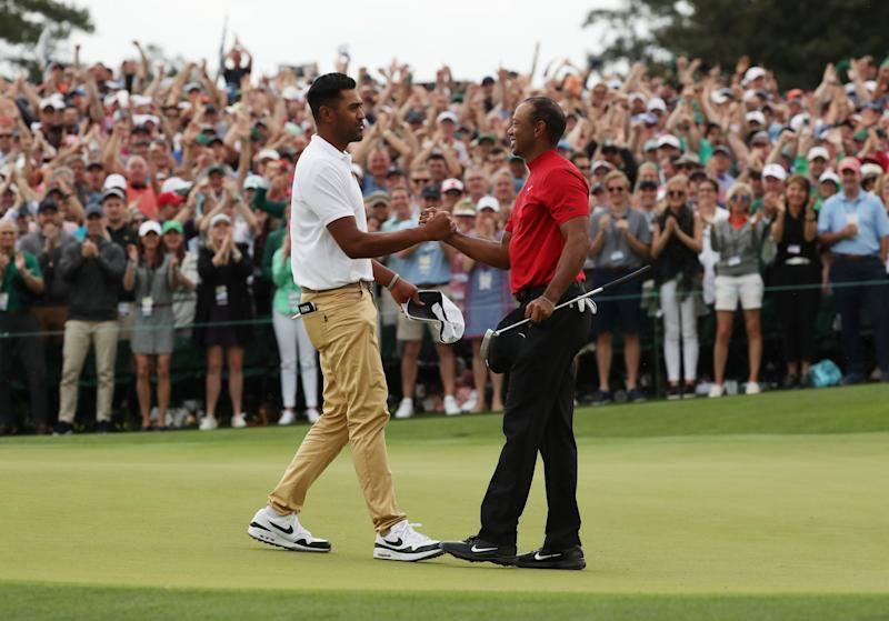 Golf - Masters - Augusta National Golf Club - Augusta, Georgia, U.S. - April 14, 2019. Tiger Woods of the U.S. shakes hands with Tony Finau of the U.S. as he celebrates on the 18th hole to win the 2019 Masters. REUTERS/Jonathan Ernst