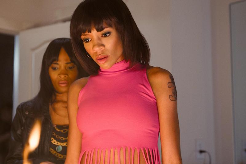"""In this undated photo provided by VH1, Lil Mama, as Lisa """"Left Eye"""" Lopes, foreground, and Markia Ashley as Lisa's cousin, are seen in a scene in the TLC biopic, """"CrazySexyCool: The TLC Story,"""" which premieres on Monday, Oct. 21, 2013, on VH1. (AP Photo/VH1, Blake Tyers)"""