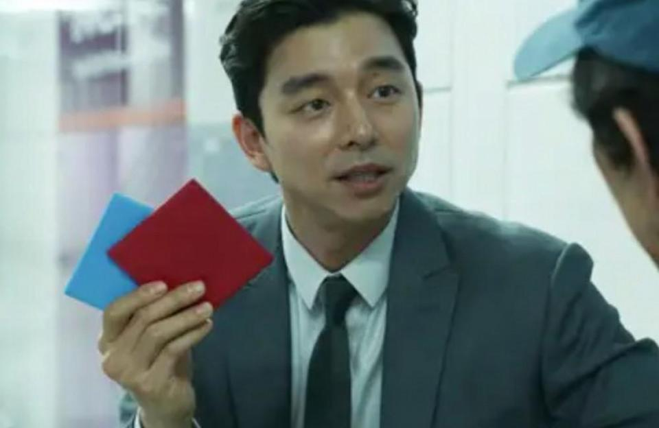"""Playing the salesman that first challenges Seong Gi-hun to a game in the subway station, Gong Yoo studied theater at university but never thought that he'd become an actor. Thanks to the Netflix hit, he's now one of the most famous actors in South Korea. His work includes 'Train to Busan', 'The Age of Shadows' and 'Coffee Prince'. He found his love for acting thanks to the cameras, as he said he finds it refreshing to focus on the character he plays, rather than on himself. He said he loves """"losing [himself] in front of the camera""""."""