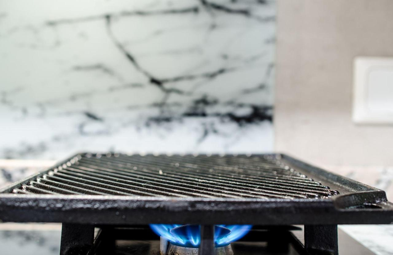 """<p>If you have a large two-burner cast iron griddle but are only <a href=""""https://www.thedailymeal.com/our-50-best-burger-recipes-gallery?referrer=yahoo&category=beauty_food&include_utm=1&utm_medium=referral&utm_source=yahoo&utm_campaign=feed"""">cooking a couple burgers</a>, resist the temptation to only turn on only one burner under it. Use both burners, because uneven heating can lead to a stress break or warping. Ideally, preheat your cast iron griddle in the oven before placing over burners on the stove.</p>"""