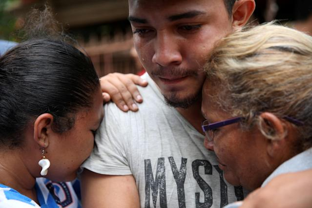 Marvin Antonio Avalos Quezada cries as he embraces relatives after being released in Masaya, Nicaragua, June 22, 2018. REUTERS/Andres Martinez Casares TPX IMAGES OF THE DAY
