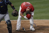 Los Angeles Angels' Mike Trout removes his helmet after striking out during the eighth inning of the team's baseball game against the Tampa Bay Rays, Thursday, May 6, 2021, in Anaheim, Calif. (AP Photo/Jae C. Hong)